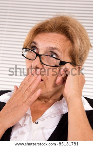cute elderly woman at office on a white