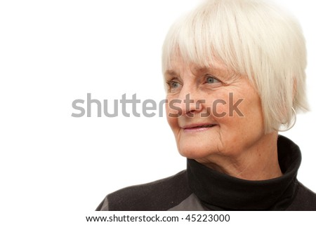 Cute elderly woman looking at copyspace to the side