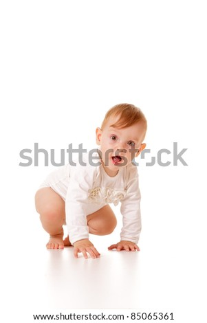 Cute eleven months old caucasian baby girl crawling, isolated.