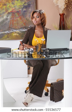 Cute executive at her desk - stock photo