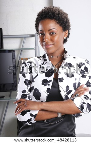 Cute executive standing confident