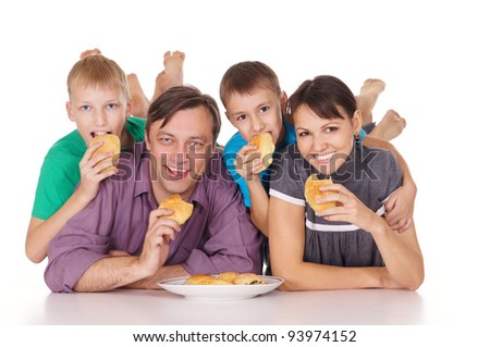 cute family eating buns on a white