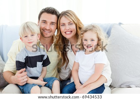 Cute family in their sofa at home
