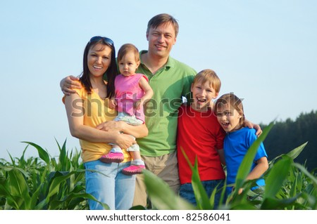 cute family of a five at nature
