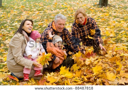 cute family of a five playing at park