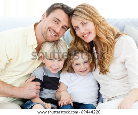Cute family on their sofa at home