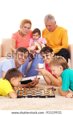 cute family playing on floor on white