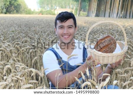 Cute farmer holding artisan bread
