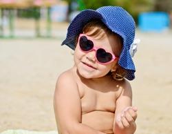cute fashion toddler girl on the beach