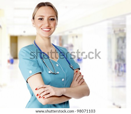 cute female doctor in a hospital with arms crossed