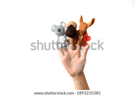 Cute finger puppet animals on hand isolated on a white background. Animals from Australia.  Foto stock ©