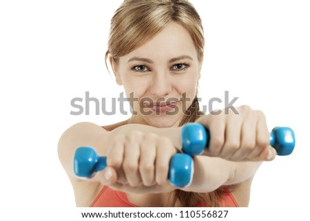 cute fitness woman exercising with blue dumbbells on white background