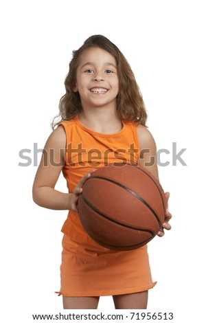 Cute five year old girl holding basketball