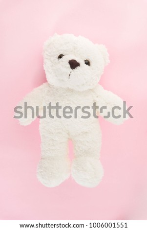 Cute fluffy white teddy bear on romantic and vintage of pink colour background. #1006001551