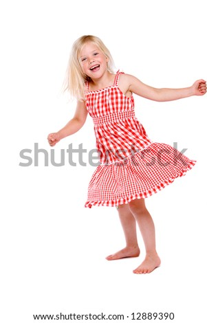 stock photo : Cute four year old girl dancing around happily