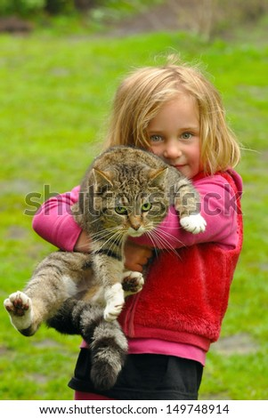 Cute four year old girl with her cat