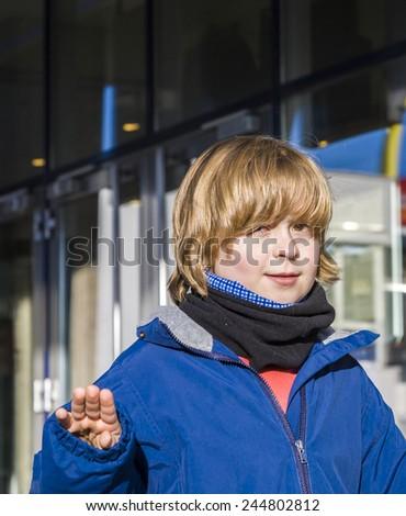 cute friendly looking boy in winter in the city