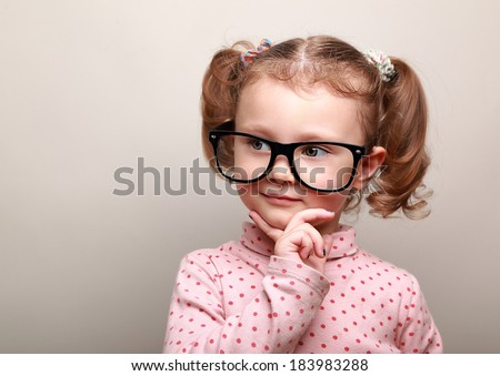 Cute fun kid girl thinking about and looking