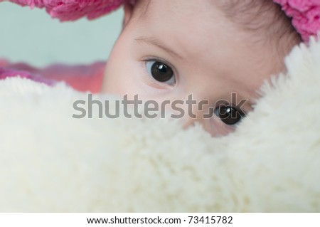 cute funny baby looking with her eyes