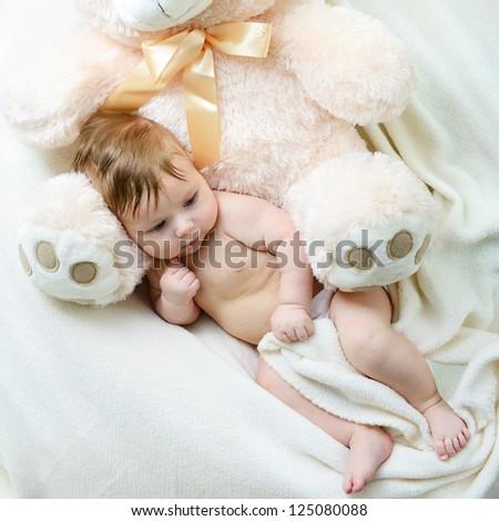 cute funny infant baby boy with big toy bear, beautiful kid\'s portrait closeup