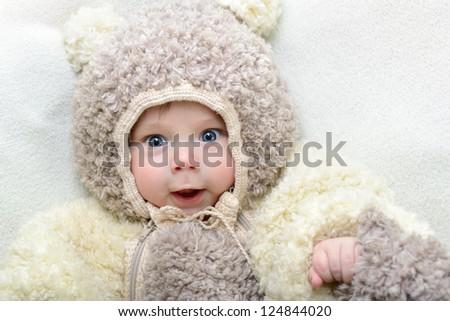 Stock Photo cute funny infant boy like a bear, beautiful kid's portrait closeup
