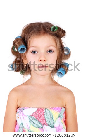 cute funny little girl wearing the curler
