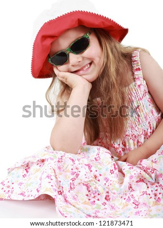 Cute funny little girl with summer hat and sunglasses
