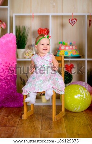 Cute funny little kid have a fun with colored balloons in the bright room  laughing
