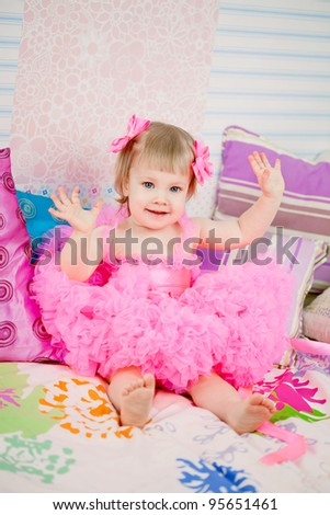 Cute girl, a child in a pink dress