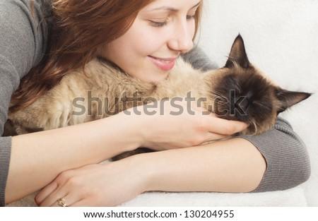 cute girl affectionately hugging  kitten