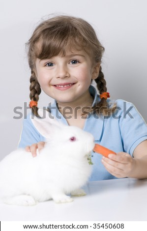 Cute girl and baby rabbit