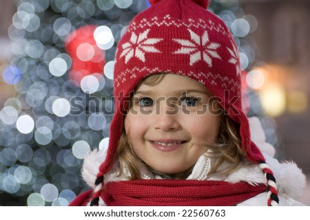 Cute girl and Christmas Tree