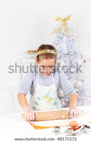 Cute girl baking cookies for Christmas