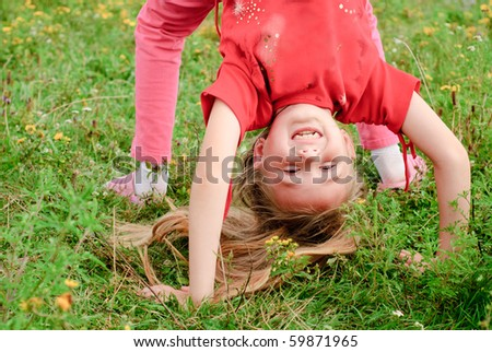 Cute girl doing bridge in the park
