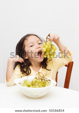 cute girl eating grapes