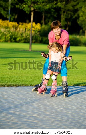 Cute girl first time in roller skates