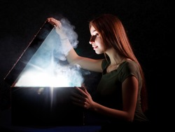 Cute girl found a treasure open mystrey box with smoke and light inside