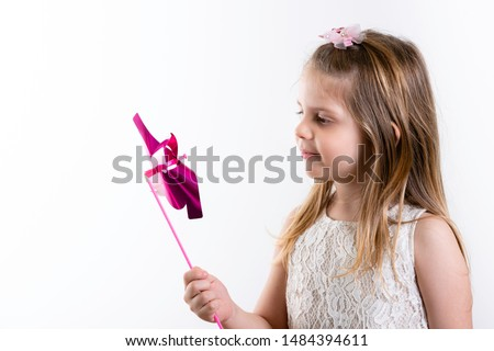 Cute Girl, Girl with Pink Pinwheel. Children's Day.