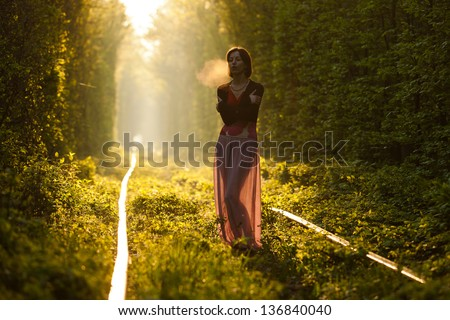 Cute girl having fun in natural tunnel of love in Ukraine, Klevan.