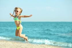 Cute girl having fun on beach