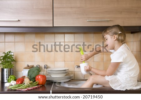 Cute girl helping in kitchen