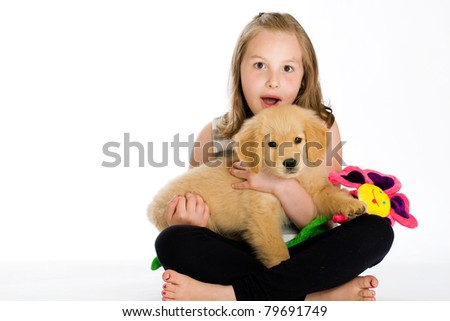 cute girl holding a cute puppy
