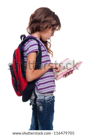 cute girl holding book and reading. studio shot over white background