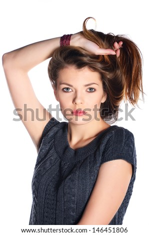 Cute girl holding her hair with her hand