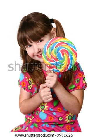 Cute Girl Holding Large Lollipop on White Background