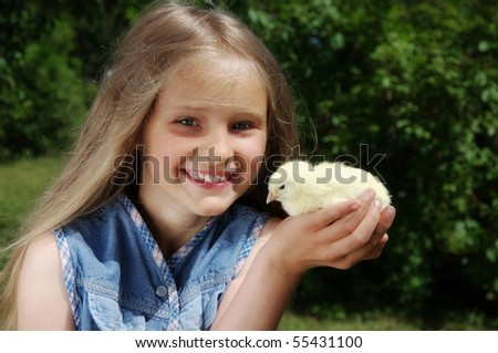 Cute girl holding little yellow chick