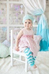 Cute girl in a gentle pastel spring decor