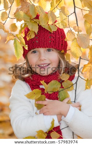 Cute girl in autumn park portrait