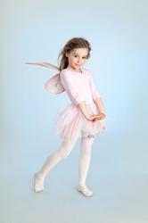 Cute girl in fairy costume posing in the studio