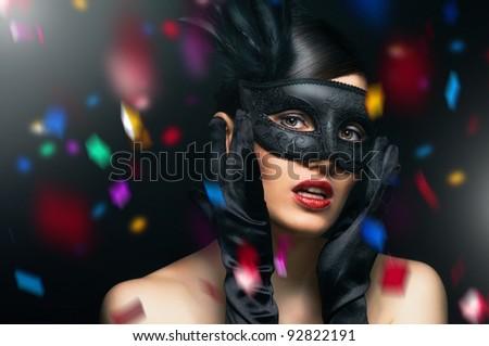 cute girl in masquerade mask - stock photo